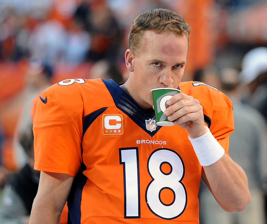 . Denver Broncos quarterback Peyton Manning (18) has focus prior to the kickoff against the Oakland Raiders at Sports Authority Field at Mile High in Denver on September 23, 2013. (Photo by Steve Nehf/The Denver Post)