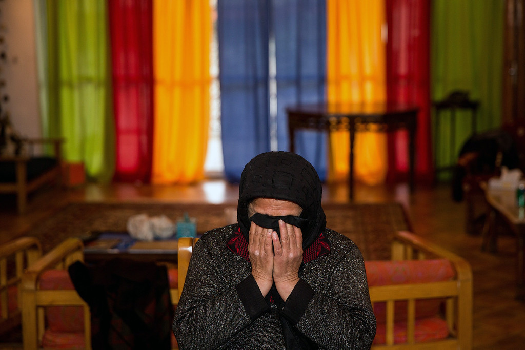 . The mother of Iranian national named Balal (C), who killed fellow Iranian youth Abdolah Hosseinzadeh in a street fight with a knife in 2007, cries in her home ahead of his execution ceremony in the northern city of Nowshahr on April 15, 2014.  AFP PHOTO/ARASH KHAMOOSHI/AFP/Getty Images