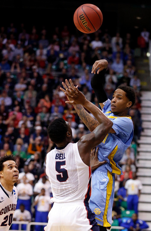 . Southern University guard Derick Beltran (2) passes over Gonzaga guard Gary Bell Jr. (5) during the first half of their second round NCAA tournament basketball game in Salt Lake City, Utah, March 21, 2013. REUTERS/Jim Urquhart
