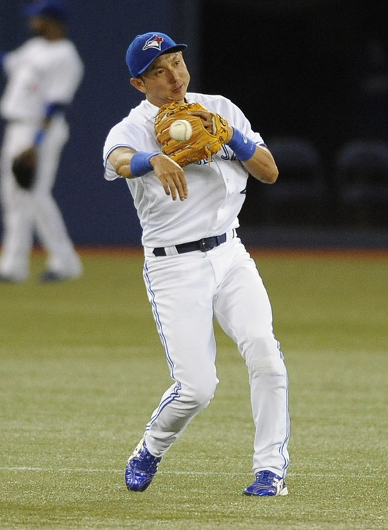 . TORONTO, CANADA - JUNE 17:  Munenori Kawasaki #66 of the Toronto Blue Jays throws to second during inter-league MLB game action against the Colorado Rockies June 17, 2013 at Rogers Centre in Toronto, Ontario, Canada. (Photo by Brad White/Getty Images)