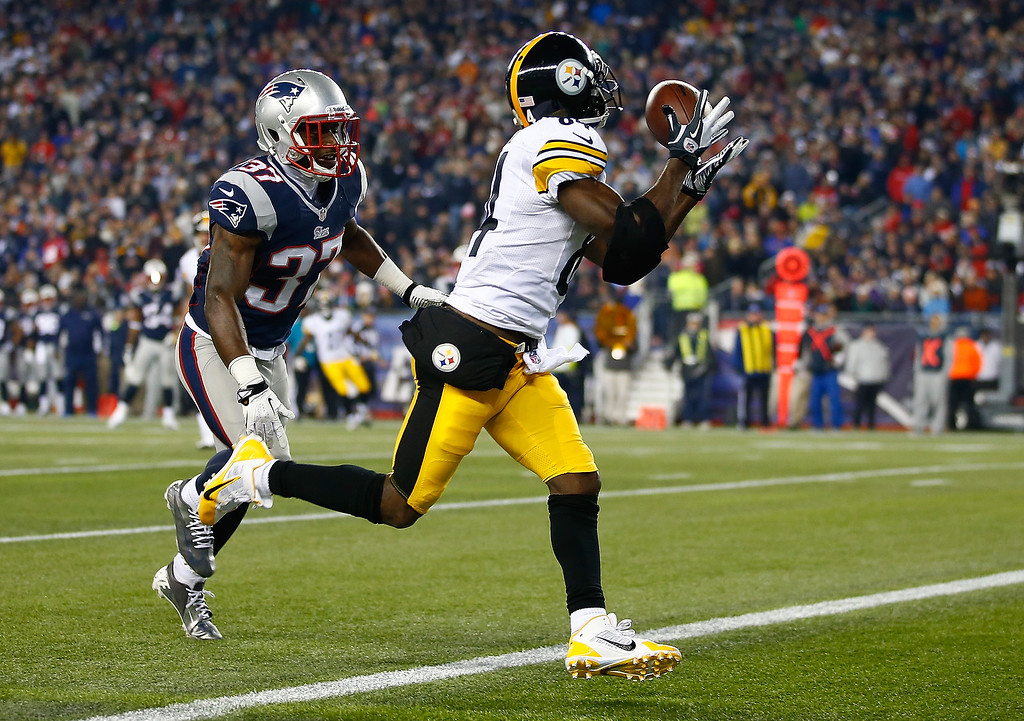 . Antonio Brown #84 of the Pittsburgh Steelers catches a touchdown pass in the second quarter in front of Alfonzo Dennard #37 of the New England Patriots at Gillette Stadium on November 3, 2013 in Foxboro, Massachusetts.  (Photo by Jared Wickerham/Getty Images)