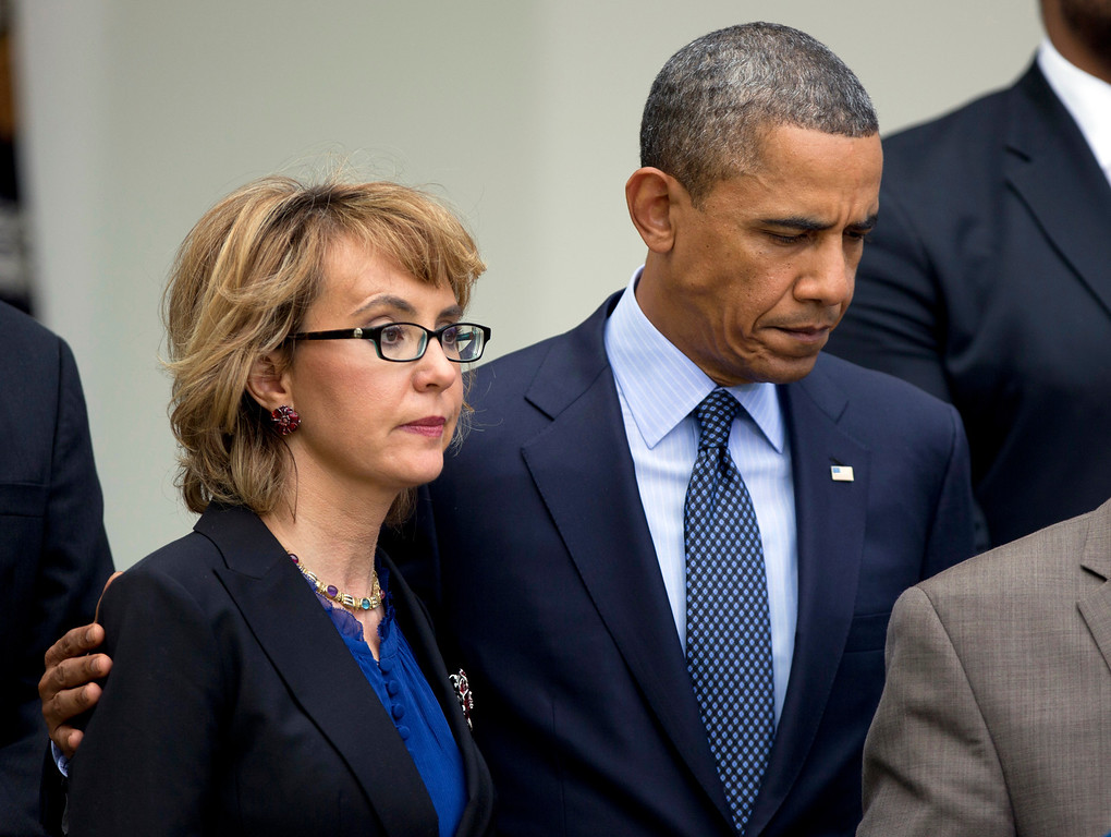 . President Barack Obama, right, puts his arm around former Rep. Gabrielle Giffords, D-Ariz., before he speaks in the Rose Garden at the White House in Washington, Wednesday, april 17, 2013, about measures to reduce gun violence.  (AP Photo/Manuel Balce Ceneta)