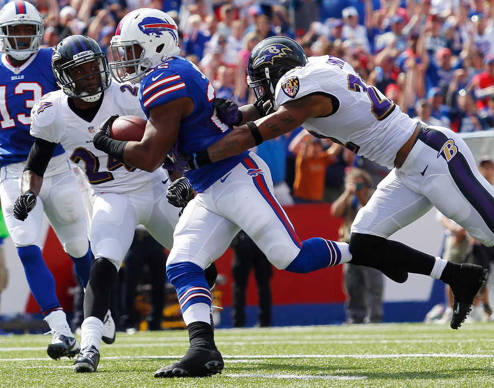 . Buffalo Bills running back Fred Jackson, center, scores a touchdown in front of Baltimore Ravens cornerback Jimmy Smith, right, and cornerback Corey Graham (24) during the first half of an NFL football game on Sunday, Sept. 29, 2013, in Orchard Park, N.Y. (AP Photo/Bill Wippert)