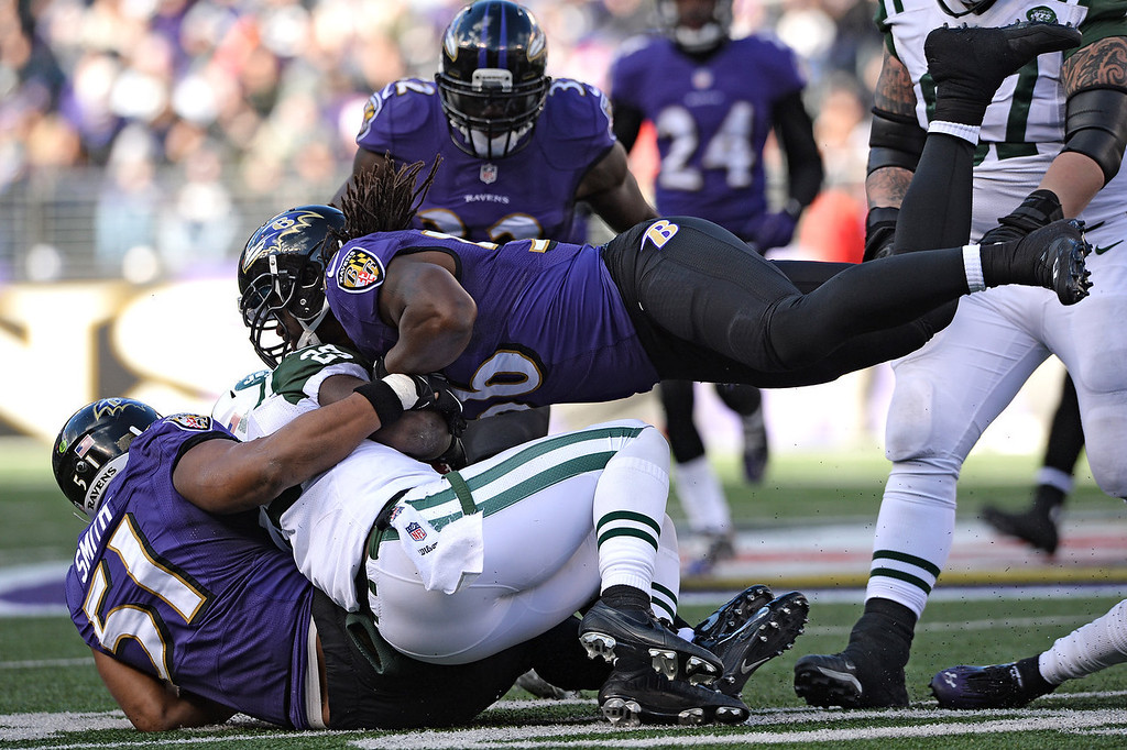 . Inside linebacker Josh Bynes #56 of the Baltimore Ravens tackles running back Mike Goodson #23 of the New York Jets in the second quarter at M&T Bank Stadium on November 24, 2013 in Baltimore, Maryland. (Photo by Patrick Smith/Getty Images)