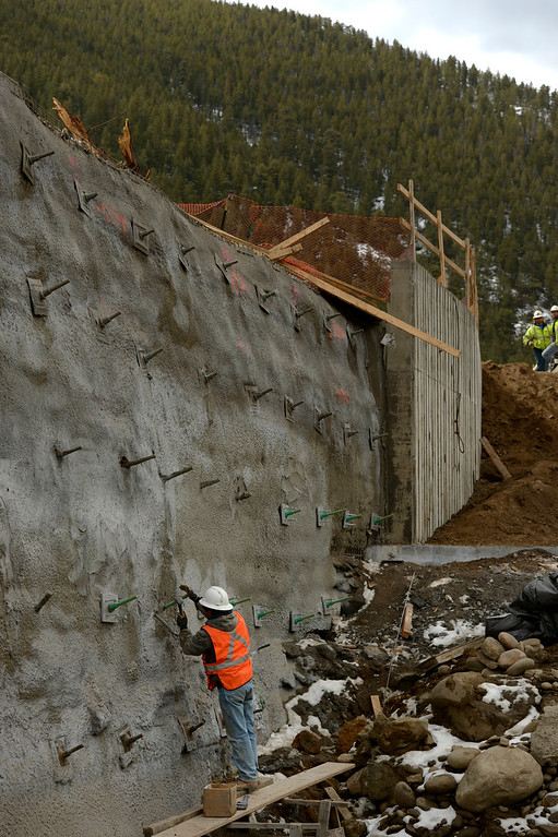 . IDAHO SPRINGS, CO- MARCH 28:  Abel Haro works on plates and large screws to keep in place a new retaining wall on the project.  This is near where the new bridge will be built that will span Clear Creek.  Construction continues on road work on I-70 and the twin tunnels near Idaho Springs on March 28th, 2013.  The highway is being widened in the east bound lanes.  The widening will start just west of the twin tunnels after Idaho Springs and will continue until the exit for Highway 6 where I-70 becomes three lanes.  They expect the project to be finished by the end of 2013.  (Photo By Helen H. Richardson/ The Denver Post)