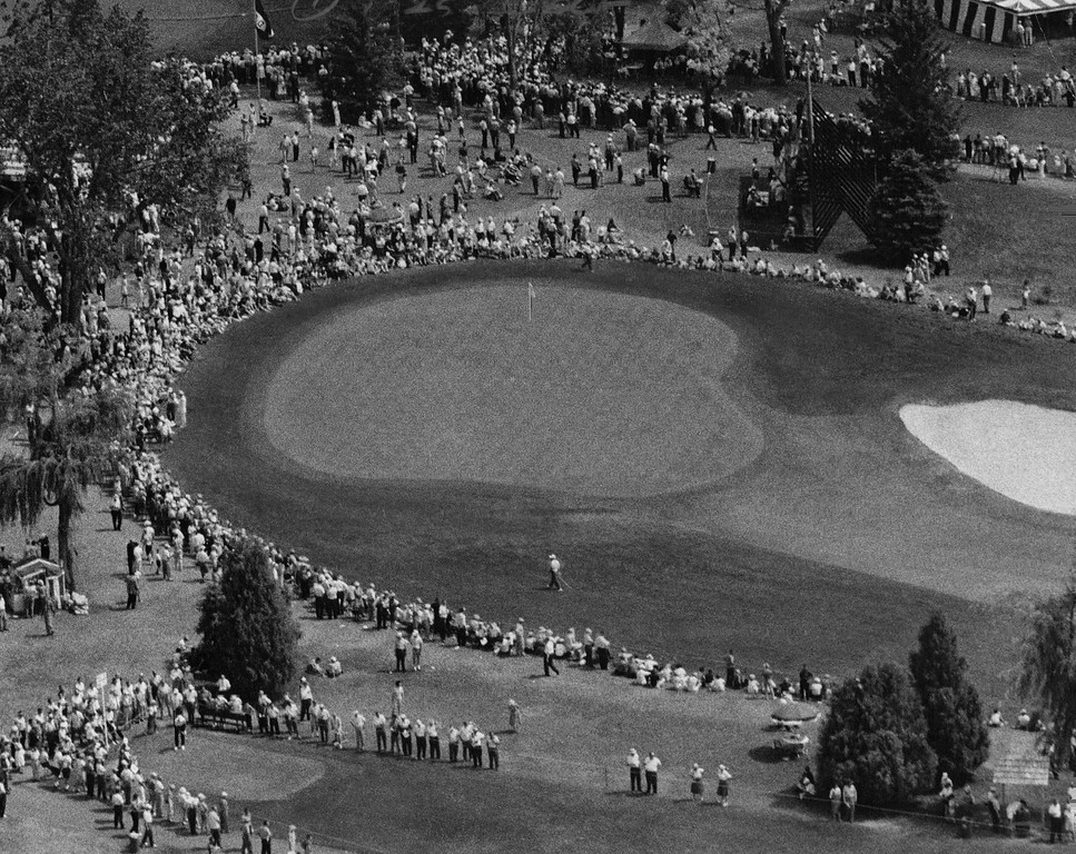 . More than 15,000 spectators lines tees, greens and fair ways to see Arnold Palmer roar from seven strokes behind to win the U.S. Open in 1960. In this picture, taken from a helicopter, are (from top) the tee, 9th green and (at bottom) 10th tee. Denver Post Library photo archive