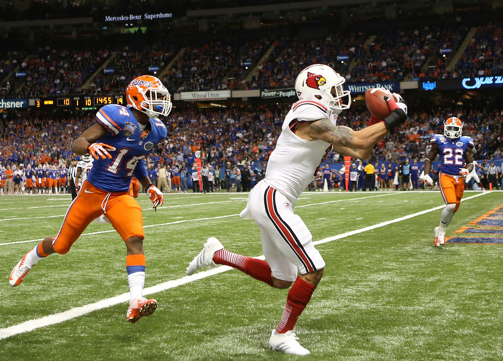 . Damian Copeland #7 of the Louisville Cardinals catches a touchdown pass over Jaylen Watkins #14 of the Florida Gators in the third quarter of the Allstate Sugar Bowl at Mercedes-Benz Superdome on January 2, 2013 in New Orleans, Louisiana.  (Photo by Matthew Stockman/Getty Images)