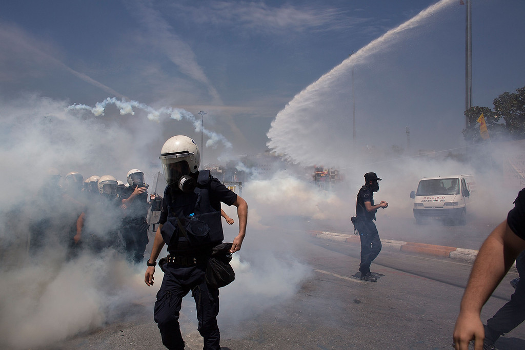 . Riot police use water cannons and tear gas to disperse the crowd during a demonstration near Taksim Square on June 11, 2013 in Istanbul, Turkey.   (Photo by Lam Yik Fei/Getty Images)