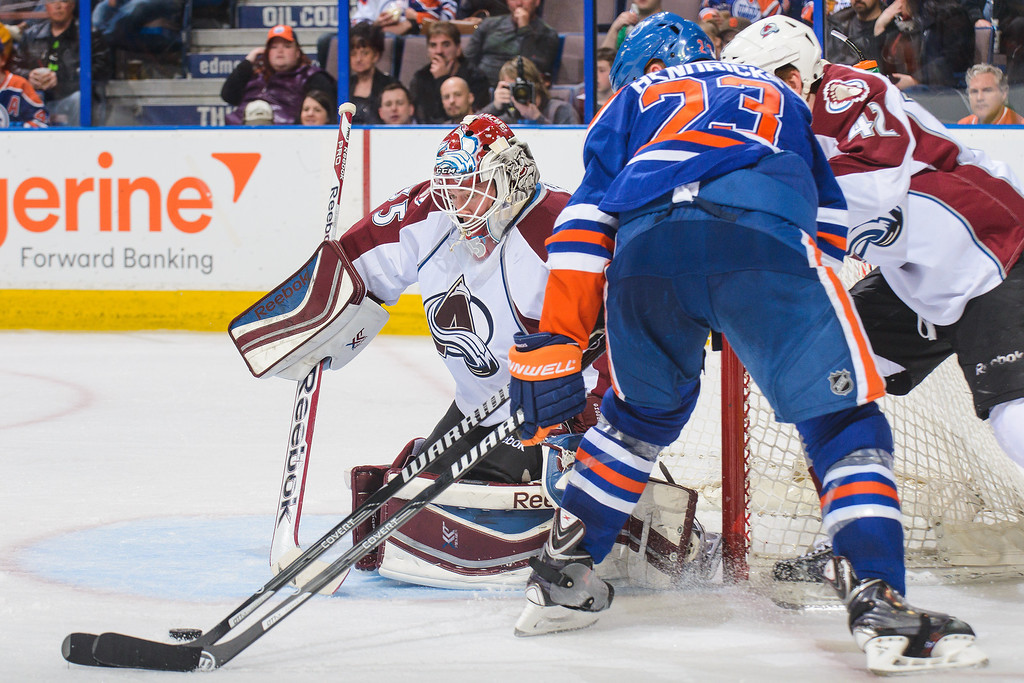 . Matt Hendricks #23 of the Edmonton Oilers takes a shot on Jean-Sebastien Giguere #35 of the Colorado Avalanche during an NHL game at Rexall Place on April 8, 2014 in Edmonton, Alberta, Canada. (Photo by Derek Leung/Getty Images)