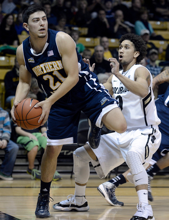 . University of Colorado\'s Askia Booker plays tight defense on Stallon Saldivar during a game against Northern Arizona on Friday, Dec. 21, at the Coors Event Center on the CU campus in Boulder.   (Jeremy Papasso/Daily Camera)