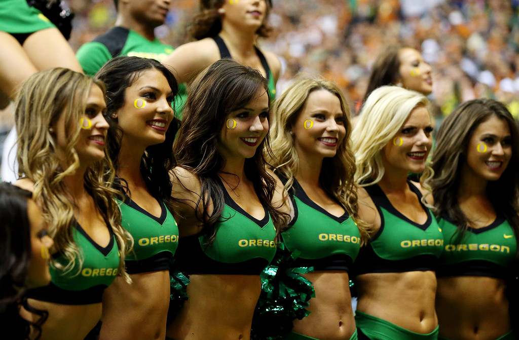 . Oregon Ducks cheerleaders perform during the Valero Alamo Bowl against the Texas Longhorns at the Alamodome on December 30, 2013 in San Antonio, Texas.  (Photo by Ronald Martinez/Getty Images)