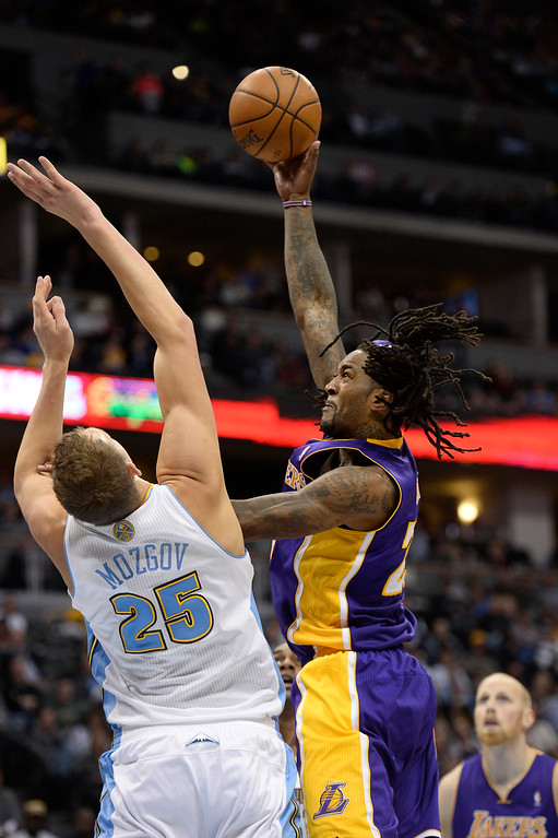 . DENVER, CO - NOVEMBER 13: Los Angeles Lakers center Jordan Hill (27) takes a shot over Denver Nuggets center Timofey Mozgov (25) during the third quarter November 13, 2013 at Pepsi Center. (Photo by John Leyba/The Denver Post)
