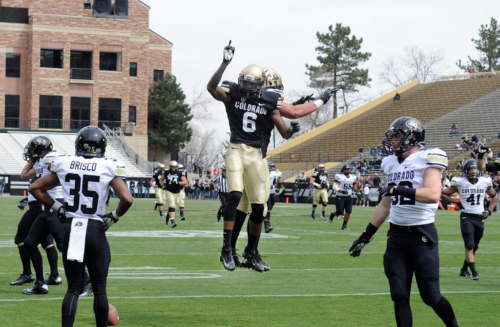 . BOULDER, CO.- APRIL13: Paul Richardson (6) celebrates his touchdown with Scott Fernandez. The University of Colorado football team hosts its spring football game at Folsom Field under the direction of new head coach Mike Macintyre. (Photo By Kathryn Scott Osler/The Denver Post)