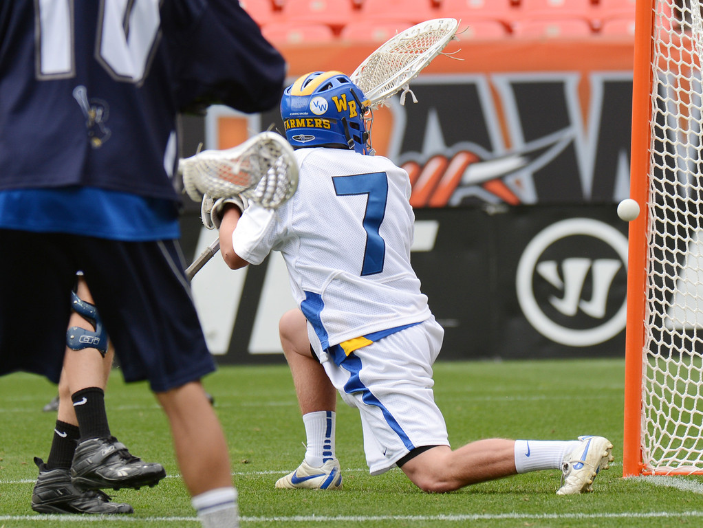 . DENVER, CO. - MAY 18 : Goalie Jensen Makarov of Wheat Ridge High School (7) is scored by Alex McAfee of Air Academy High School (3) during 4A Boy\'s Lacrosse Championship game at Sports Authority Field at Mile High Stadium. Denver, Colorado. May 18, 2013. (Photo By Hyoung Chang/The Denver Post)