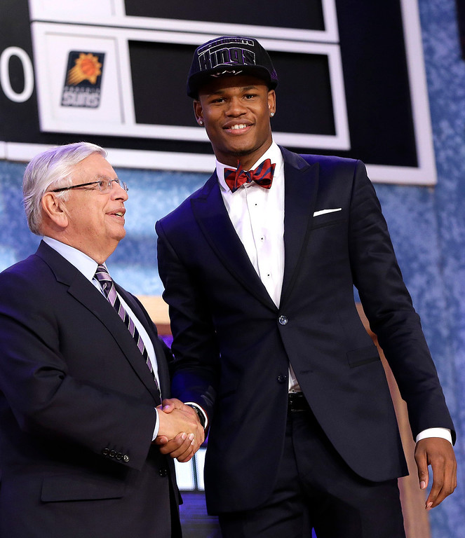 . NBA Commissioner David Stern, left, shakes hands with Kansas\' Ben McLemore, who was selected by the Sacramento Kings in the first round of the NBA basketball draft, Thursday, June 27, 2013, in New York. (AP Photo/Kathy Willens)