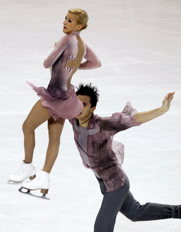 . Tatiana Volosozhar (L) and Maxim Trankov of Russia perform their free skating program at the ISU World Figure Skating Championships in London, March 15, 2013.   REUTERS/Fred Thornhill