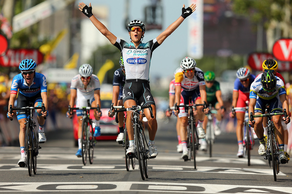 . LYON, FRANCE - JULY 13:  Matteo Trentin of Italy and Omega Pharma-Quickstep celebrates winning stage fourteen of the 2013 Tour de France, a 191KM road stage from Saint-Pourcain-sur-Sioule to Lyon, on July 13, 2013 in Lyon, France.  (Photo by Bryn Lennon/Getty Images)