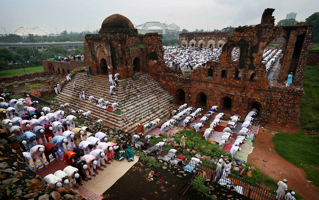 . Muslims offer prayers on the occasion of Eid al-Fitr in the ruins of the Feroz Shah Kotla Mosque in New Delhi, India, Friday, Aug. 9, 2013. Eid al-Fitr marks the end of the holy month of Ramadan, during which Muslims all over the world fast from sunrise to sunset. (AP Photo/Saurabh Das)