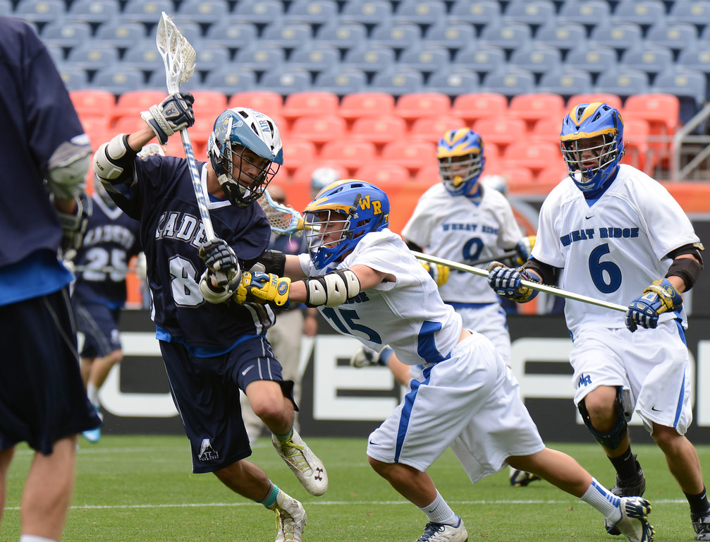. DENVER, CO. - MAY 18 : Alec Finley of Air Academy High School (8) controls the ball under the pressure of  Bennie Pachello of Wheat Ridge High School (15) during 4A Boy\'s Lacrosse Championship game at Sports Authority Field at Mile High Stadium. Denver, Colorado. May 18, 2013. (Photo By Hyoung Chang/The Denver Post)