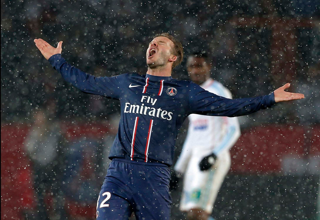 . Paris Saint Germain\'s David Beckham reacts during their League One soccer match against  Marseille at Parc des Princes Stadium, in Paris, Sunday Feb. 24, 2013. Beckham made his Paris St Germain debut. (AP Photo/Francois Mori, File)