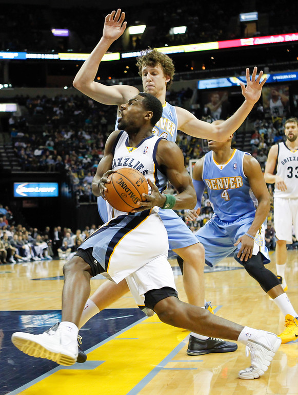 . Memphis Grizzlies guard Tony Allen (9) goes to the basket against Jan Vesely in the second half of an NBA basketball game Friday, April 4, 2014, in Memphis, Tenn. The Grizzlies won 100-92. (AP Photo/Lance Murphey)