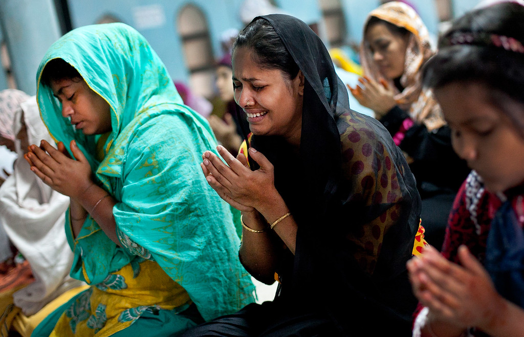 . A women looks emotional as she performs Eid-al-Adha prayers at the National Mosque on October 16, 2013 in Dhaka, Bangladesh. (Photo by Getty Images/Getty Images)
