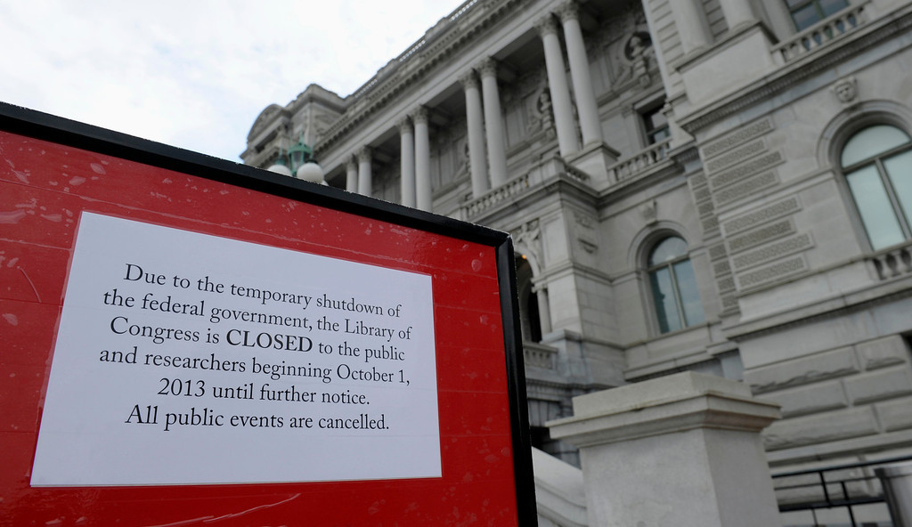 . A sign explaining the closing of the Library of Congress is posted outside the Library of Congress in Washington, Tuesday, Oct. 1, 2013.    (AP Photo/Susan Walsh)