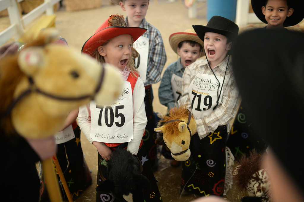 . DENVER, CO. JANUARY 25: Kira Butchart, 6, (705) and fellow competitors huddle up during the stick horse rodeo at Ames Activity Pavilion at the National Western Stock Show in Denver, Colorado January 25, 2014. Twenty-eight children competed in the event. (Photo by Hyoung Chang/The Denver Post)