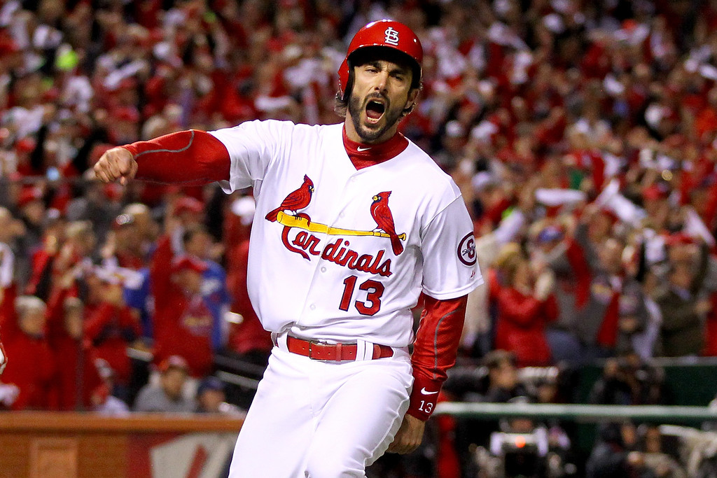 . ST LOUIS, MO - OCTOBER 18:  Matt Carpenter #13 of the St. Louis Cardinals reacts after scoring a run in the third inning against the Los Angeles Dodgers in Game Six of the National League Championship Series at Busch Stadium on October 18, 2013 in St Louis, Missouri.  (Photo by Dilip Vishwanat/Getty Images)
