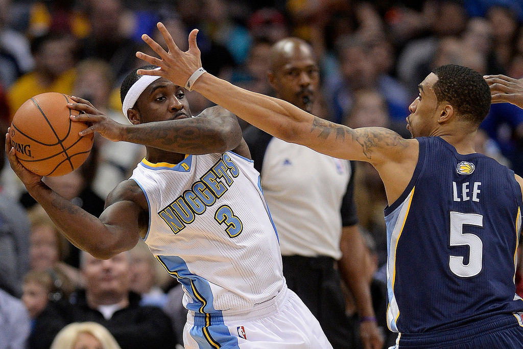 . Memphis Grizzlies guard Courtney Lee (5) defends Denver Nuggets guard Ty Lawson (3) during the second quarter. The Denver Nuggets hosted the Memphis Grizzlies at the Pepsi Center on Monday, March 31, 2014. (Photo by AAron Ontiveroz/The Denver Post)