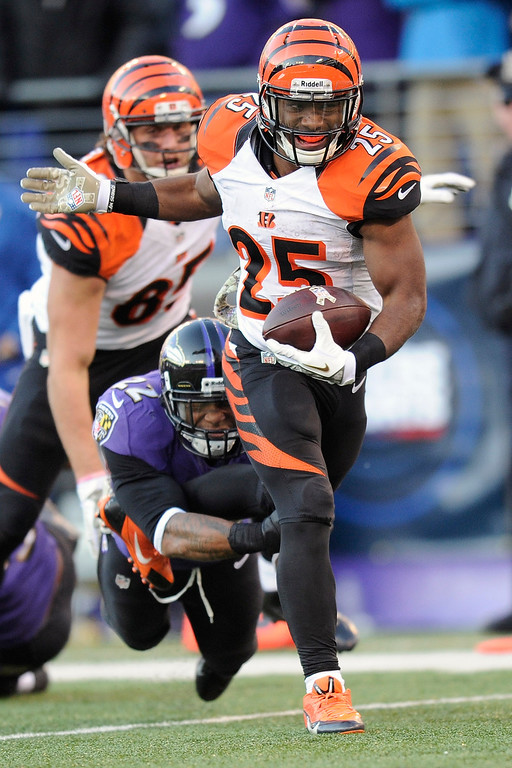 . Cincinnati Bengals running back Gio Bernard (25) breaks a tackle from Baltimore Ravens cornerback Jimmy Smith and scores a touchdown during the second half of an NFL football game in Baltimore, Sunday, Nov. 10, 2013. (AP Photo/Nick Wass)