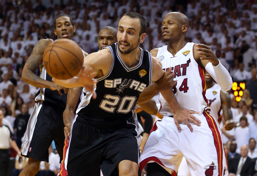 . Manu Ginobili #20 of the San Antonio Spurs goes after a loose ball in front of Ray Allen #34 of the Miami Heat during Game Six of the 2013 NBA Finals at AmericanAirlines Arena on June 18, 2013 in Miami, Florida.   (Photo by Mike Ehrmann/Getty Images)