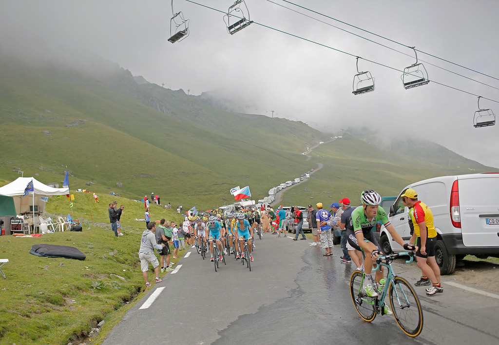 . Netherlands\' Lars Boom, right, breaks away from the pack when climbing Tourmalet pass during the eighteenth stage of the Tour de France cycling race over 145.5 kilometers (90.4 miles) with start in Pau and finish in Hautacam, Pyrenees region, France, Thursday, July 24, 2014. (AP Photo/Laurent Cipriani)