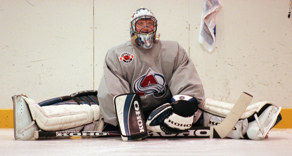 . Colorado Avalanche goalie Patrick Roy stretches before  practice in 1999. (Andy Cross/The Denver Post)