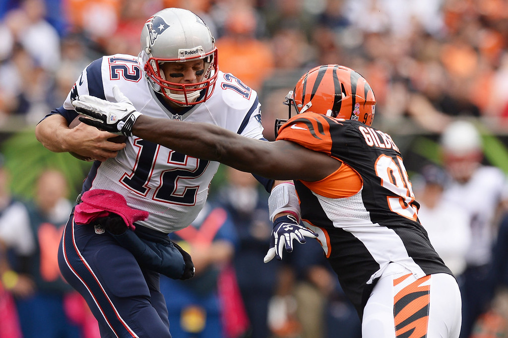 . Wallace Gilberry #95 of the Cincinnati Bengals sacks quarterback Tom Brady #12 of the New England Patriots in the first quarter at Paul Brown Stadium on October 6, 2013 in Cincinnati, Ohio.  (Photo by Jamie Sabau/Getty Images)