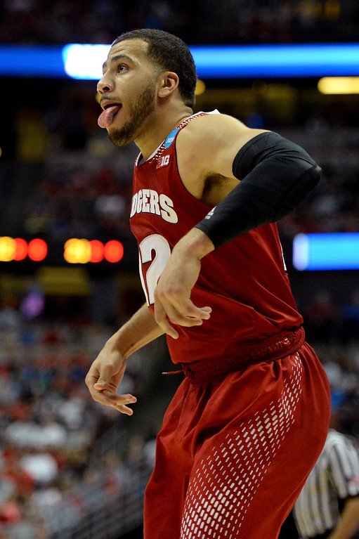 . Traevon Jackson #12 of the Wisconsin Badgers reacts in the second half while taking on the Arizona Wildcats during the West Regional Final of the 2014 NCAA Men\'s Basketball Tournament at the Honda Center on March 29, 2014 in Anaheim, California.  (Photo by Harry How/Getty Images)