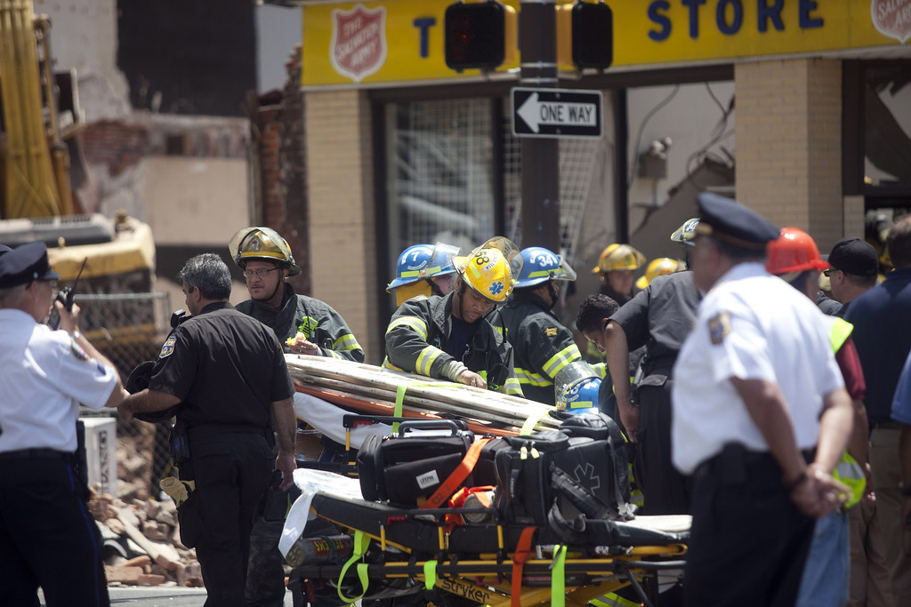 . Rescue workers search for victims and clear debris from a building that collapsed in an apparent accident at a demolition site, at 22nd and Market Streets, June 5, 2013 in Philadelphia, Pennsylvania. (Photo by Jessica Kourkounis/Getty Images)
