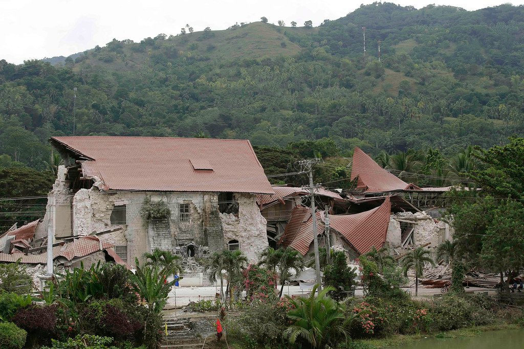. Debris lies near the damaged Saint Peter church in Loboc township, Bohol province in central Philippines Wednesday, Oct. 16, 2013, a day after a 7.2-magnitude quake hit Bohol and Cebu provinces.   (AP Photo/Bullit Marquez)