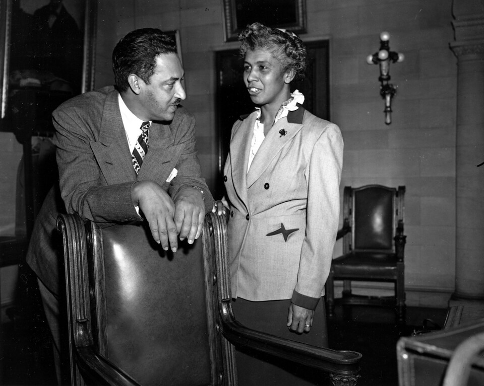 . Thurgood Marshall, chief legal counsel for the National Association for the Advancement of Colored People, or NAACP, and Alveta Shultz, parent of a school child, are shown prior to a hearing in Albany, N.Y., November 9, 1949. Marshall and Shultz are scheduled to meet with the New York State Commissioner of Education, Francis T. Spaulding, regarding the integration case of Prospect School in Hempstead, Long Island, New York. (AP Photo)