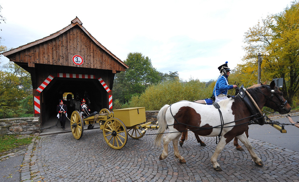. Members of a local historical society dressed as soldiers of the 8th Artillery Regiment, 5th Division Dufour serving under Napoleon, prepare to begin their four-day march to Leipzig on October 14, 2013 in Schellenberg, Germany. (Photo by Matthias Rietschel/Getty Images)