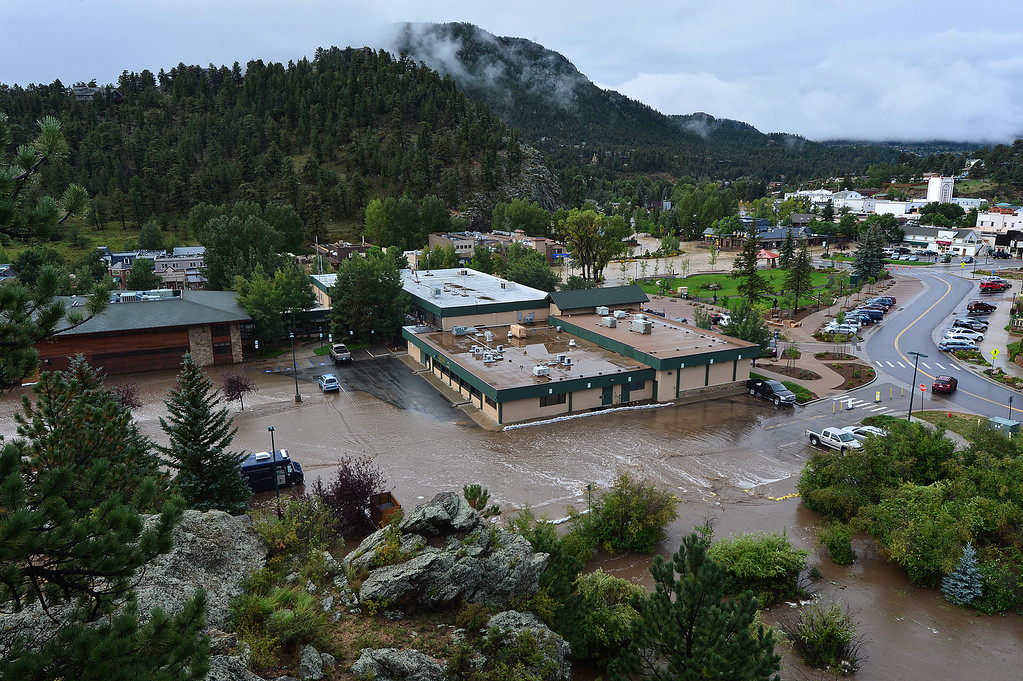 . A normally tiny stream floods the police station parking on Saturday, September 14, 2013. Walt Hester/Estes Park Trail-Gazette