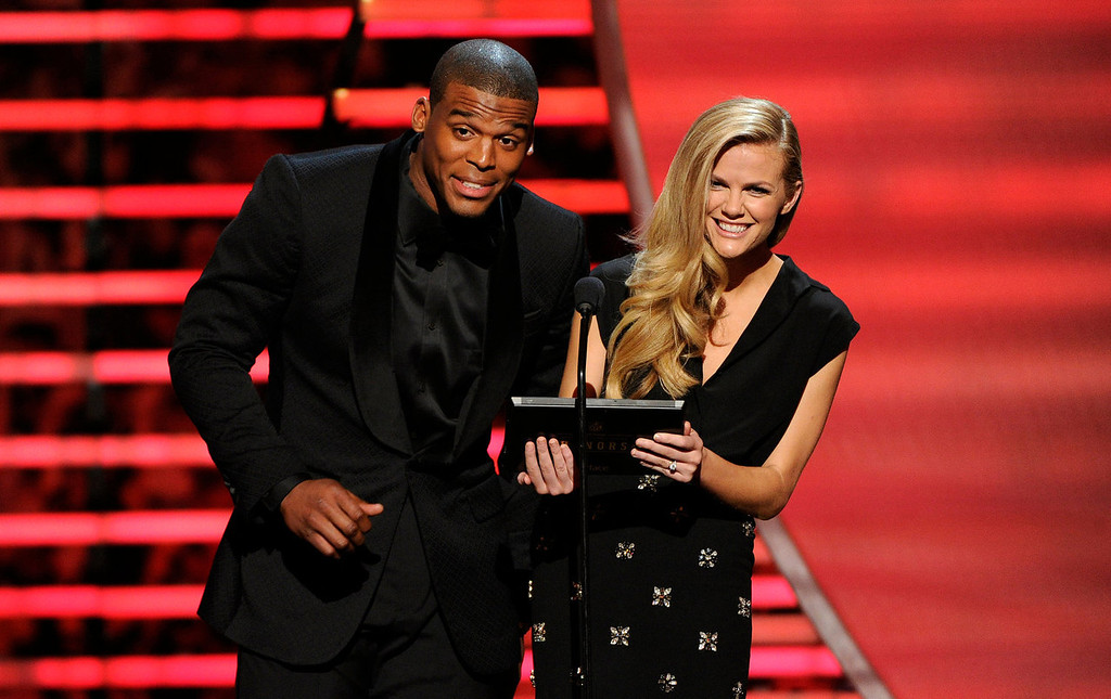 . Carolina Panthers\' Cam Newton, left, and model Brooklyn Decker speak on stage at the thirrd annual NFL Honors at Radio City Music Hall on Saturday, Feb. 1, 2014, in New York. (Photo by Evan Agostini/Invision for NFL/AP Images)