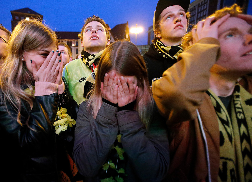 . Borussia Dortmund supporters react during a public viewing of the Champions League Final soccer match between Borussia Dortmund and Bayern Munich in Dortmund, Germany, Saturday, May 25, 2013. (AP Photo/Frank Augstein)