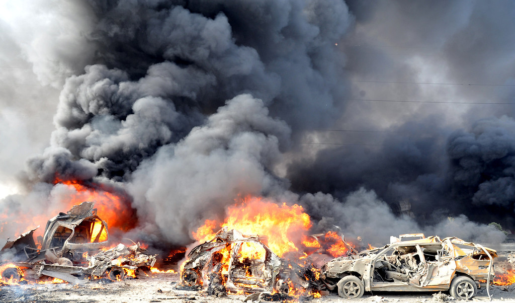 ". A handout picture from the Syrian Arab News Agency (SANA) shows smoke rising from burning cars at the site of twin blasts in Damascus on May 10, 2012. Two powerful blasts in quick succession rocked the Syrian capital at morning rush hour, killing and wounding dozens of people, state television said, blaming the attacks on ""terrorists.\"" -/AFP/GettyImages"