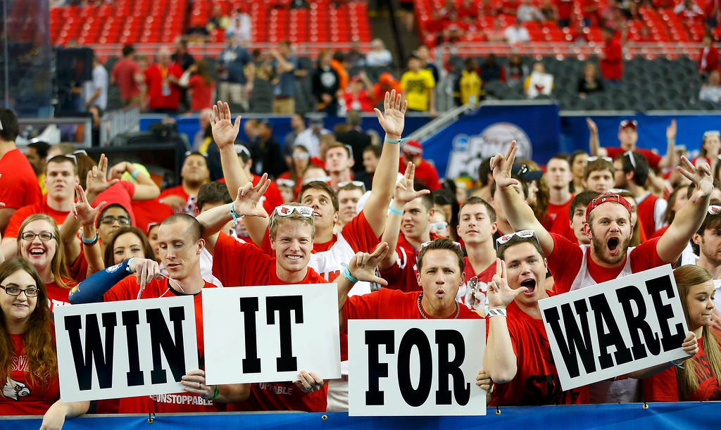 . Louisville fans hold signs referring to injured player Kevin Ware ahead of the NCAA men\'s Final Four basketball game between the Wichita State Shockers and the Louisville Cardinals in Atlanta, Georgia April 6, 2013.  REUTERS/Chris Keane