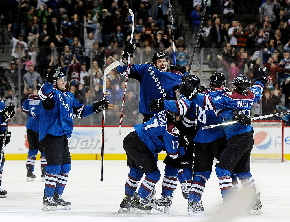 . The Colorado Avalanche celebrate a game-winning goal as time expires by Colorado Avalanche center Matt Duchene of an NHL hockey game against the San Jose Sharks on Sunday, March 10, 2013, in Denver. The Avalanche won 3-2 in overtime. (AP Photo/Chris Schneider)
