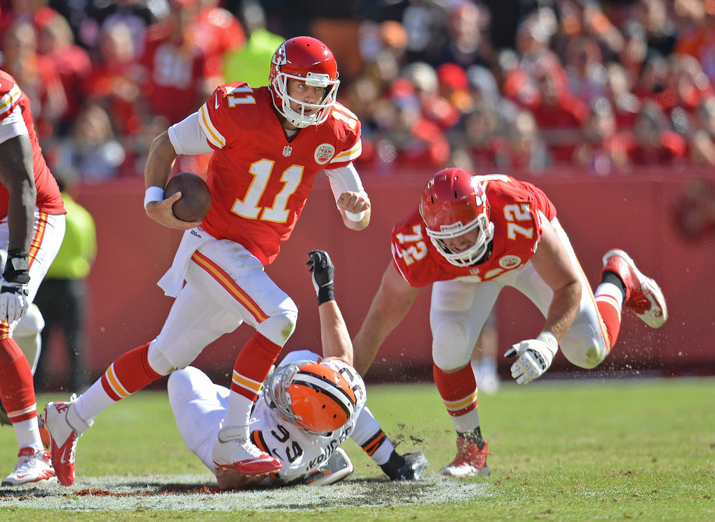 . Quarterback Alex Smith #11 of the Kansas City Chiefs scrambles out of the pocket past linebacker Paul Kruger #99 of the Cleveland Browns during the first half on October 27, 2013 at Arrowhead Stadium in Kansas City, Missouri. Kansas City won 23-17. (Photo by Peter Aiken/Getty Images)