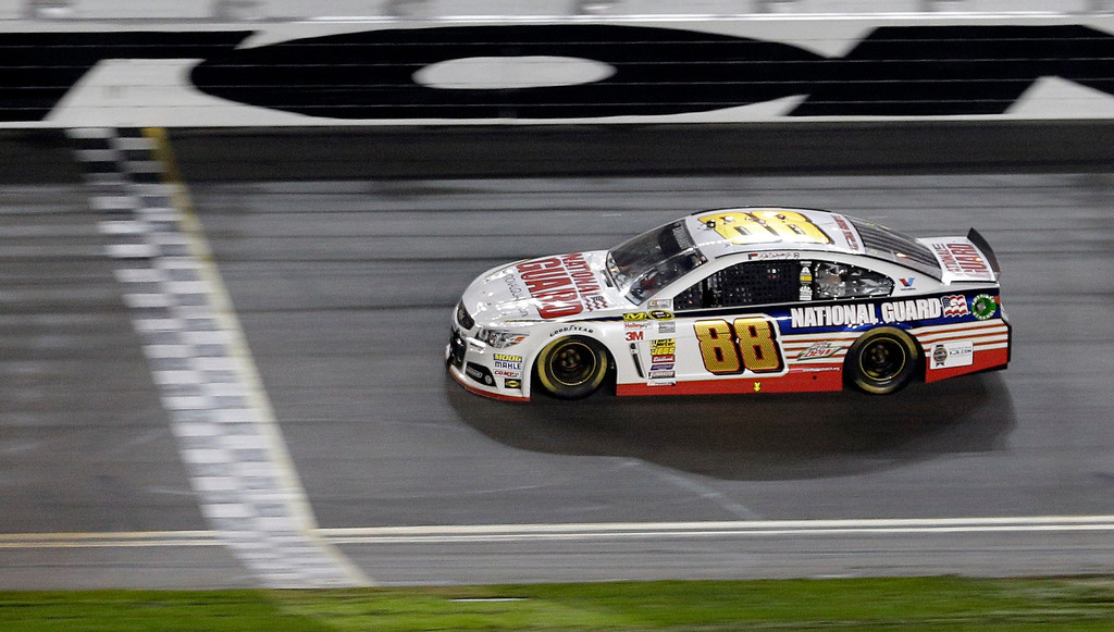 . Dale Earnhardt Jr. (88) races to the finish line to win the NASCAR Daytona 500 Sprint Cup series auto race at Daytona International Speedway in Daytona Beach, Fla., Sunday, Feb. 23, 2014. (AP Photo/Chuck Burton)