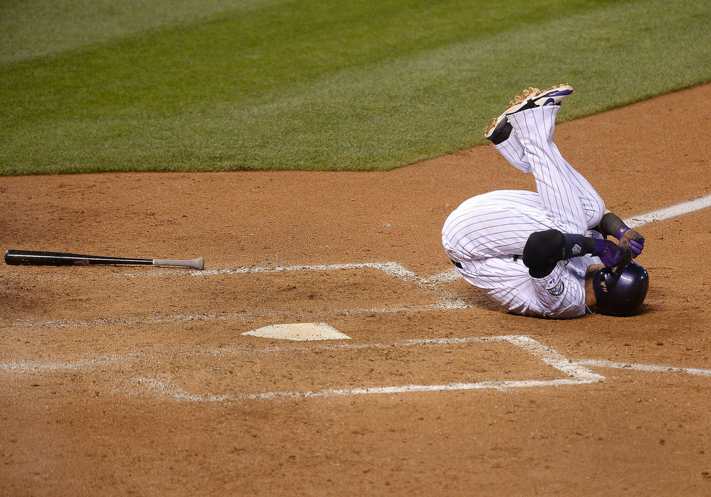 . Colorado batter Troy Tulowitzki rolled on the ground after he was hit by a pitch from Giants starter Madison Bumgarner in the fifth inning.  (Photo by Karl Gehring/The Denver Post)