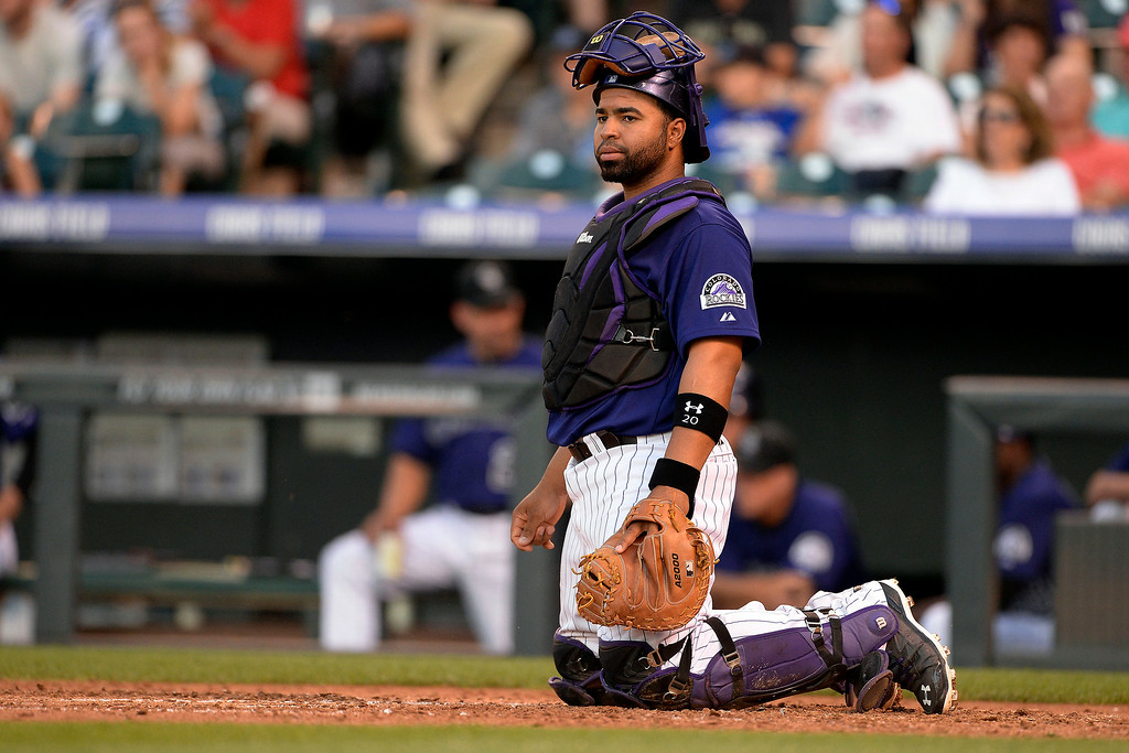 . Wilin Rosario (20) of the Colorado Rockies reacts to a four-run fourth inning by the Washington Nationals at Coors Field. Major League Baseball action between the Colorado Rockies and the Washington Nationals on Monday, July 21, 2014. (Photo by AAron Ontiveroz/The Denver Post)